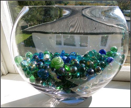 Marbles and a Curved Bowl in a Window