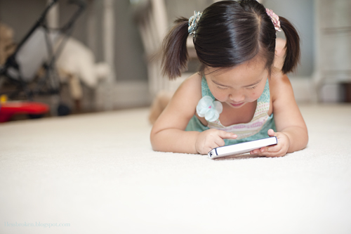 BLOG lily playing on phone