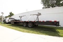 asphalt(0.0), trailer truck(0.0), automotive exterior(1.0), commercial vehicle(1.0), vehicle(1.0), transport(1.0), trailer(1.0), bumper(1.0), land vehicle(1.0),