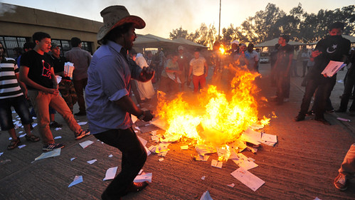 Protesters set fire to piles of voting materials after storming the office of the national election commission in Benghazi July 1, 2012. by Pan-African News Wire File Photos