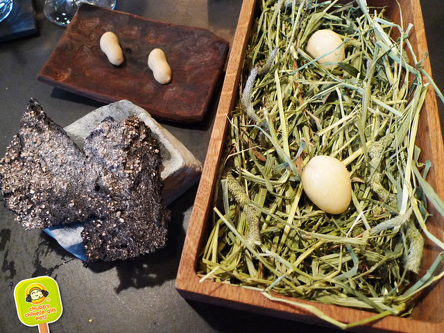 Atera - pickled quail eggs, foie gras peanut, rye cracker