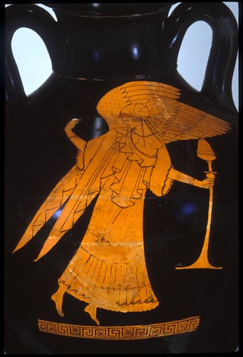 A winged Nike (goddess of victory) hovers above the ground, holding a flowering tendril and a smoking censer.