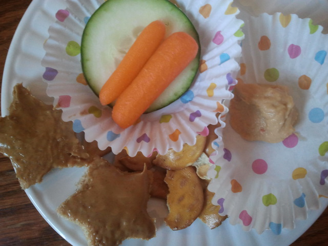 Addy eats: star shaped toast with peanut butter, pretzel thins, carrots and cucumber with hummus