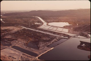 Imperial Dam takes last of Colorado River water for the United States. It diverts water into All-American Canal. Desilting basins in center background, May 1972