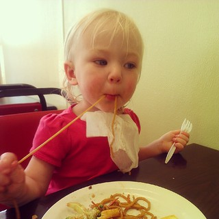 Elliora gobbling up chicken lo mein