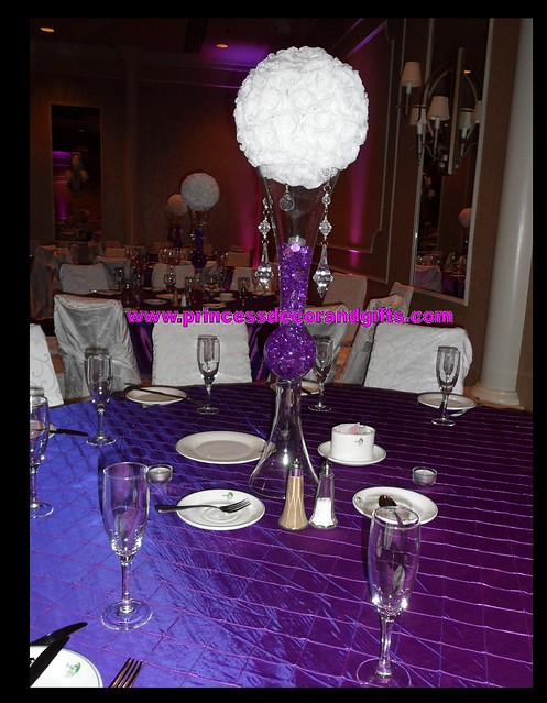White rose ball centerpieces and purple table cloths