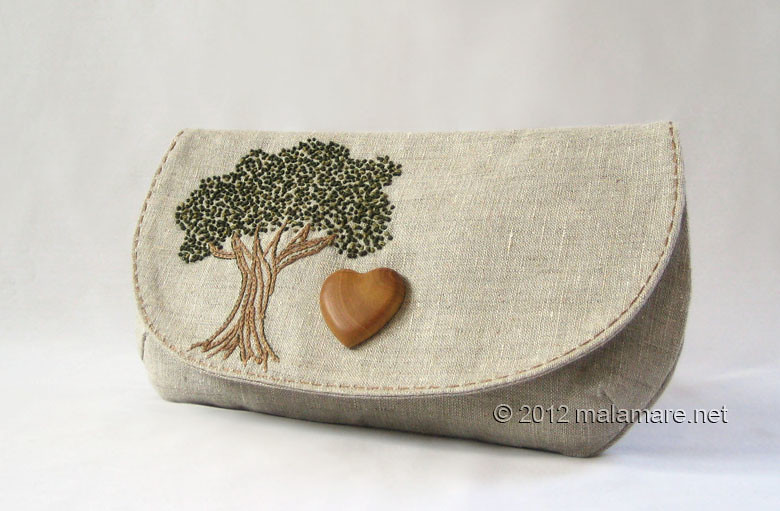 natural linen fabric clutch bag with olive wood heart and hand embroidered tree motif