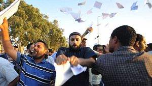 Libyan crowds in Benghazi tearing up ballots for the sham elections slated for July 7. Since the bombing and overthrow of the Gaddafi government the North African state has descended into chaos. by Pan-African News Wire File Photos