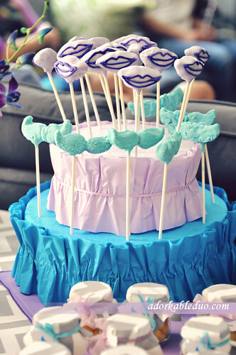 gender reveal turquoise mustache and lavender lip cake pops on DIY styrofoam cake base