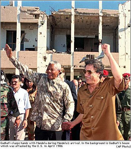 Martyred former leader of Libya Col. Muammar Gaddafi takes former South African President Nelson Mandela on a tour of the bombed-out area where the U.S. attacked the North African state in April 1986. Twenty five years later the Gaddafi was overthrown. by Pan-African News Wire File Photos