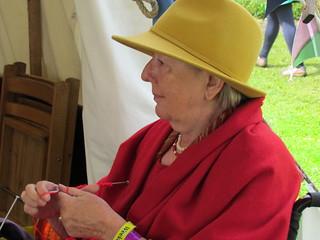 Maggie knitting at dovegreyreader's tent