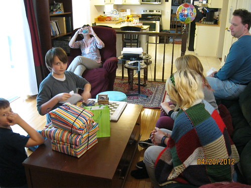 4/20/12: The family watches the gift opening.