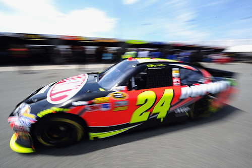 Jeff Gordon drives the #24 DuPont Chevrolet through the garage area during practice for the NASCAR Sprint Cup Series Capital City 400 at Richmond International Raceway on April 27, 2012 in Richmond, Virginia