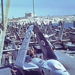 July 27, 1955: returning HMAS VENGEANCE loads RN aircraft in Malta - CPO Jack Duperouzel.
