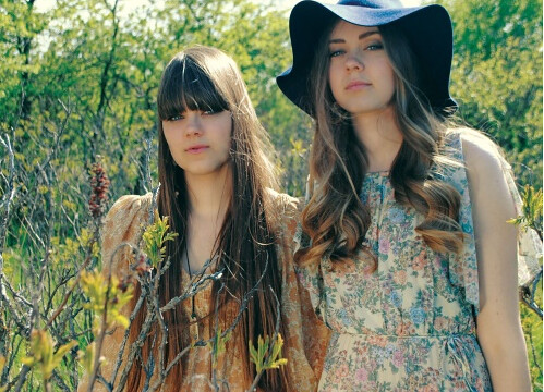 First Aid Kit--two young white women standing in a field