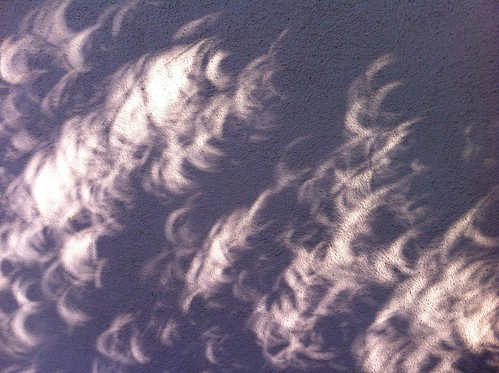 Eclipse crescents on wall