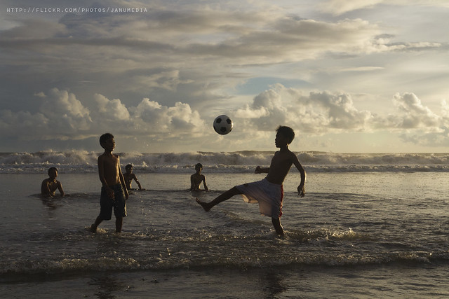 Balinese Kids playing Soccer Beach at Yeh Gangga Beach, Tabanan, Bali