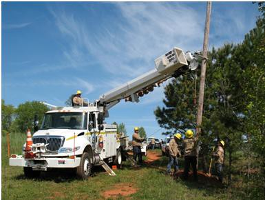 "Blue Ridge Electric Co-op employees spend the morning placing ""dummy"" power lines at a dove field on the Sumter National Forest, Friday, April 13, 2012.  The field is used exclusively by youth and mobility-impaired hunters. (Forest Service photo)"