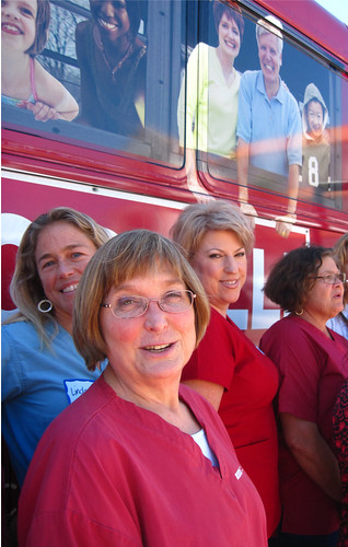 Donna and Nurses in front of bus