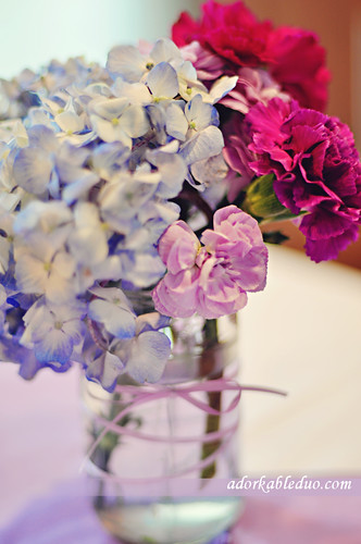 hydrangea and carnation flower arrangement to get more blue and purple in the decor for gender reveal party - adorkableduo.com