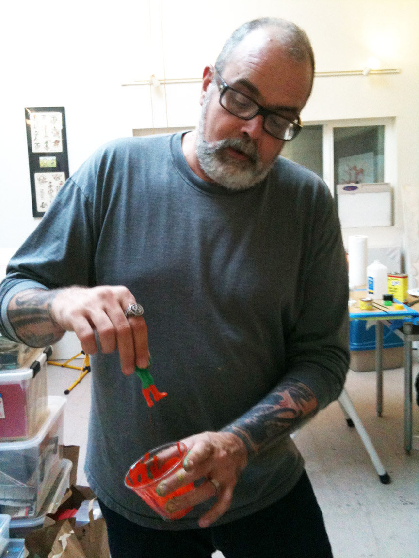 Frank Kozik working on his Sucklord figures