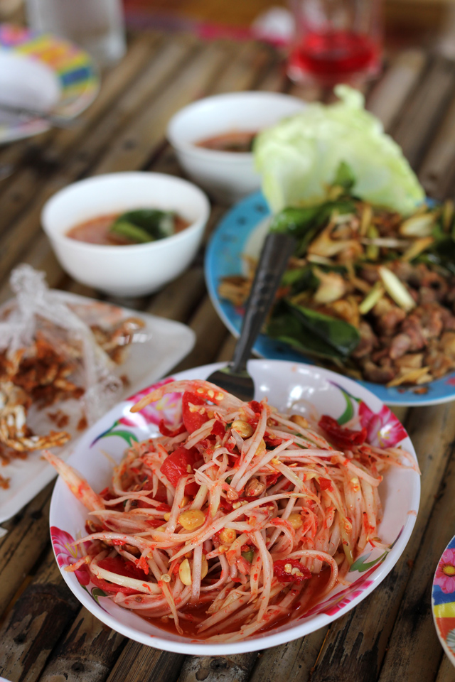Flaming plate of Thai green papaya salad