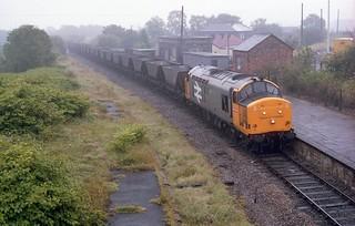 37896 at a very moist Tondu hauling empty MGR HAA Hoppers 15/07/1987