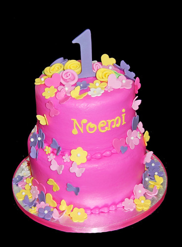 1st birthday pink purple and yellow cake with butterflies, flowers and hearts