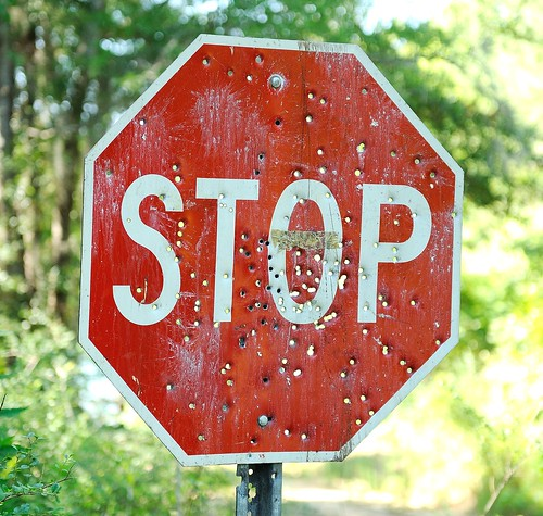 Vandalized stop sign