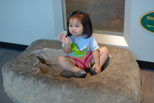 Sitting in a dinosaur's footprint :)