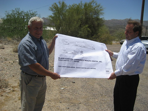 Architect Gary King and Dr. Randy Hancock look over the plans for the new Black Canyon Community Health Center.