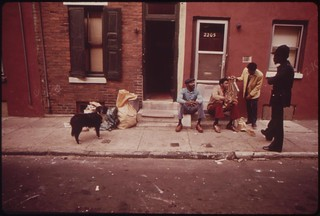 """North Philadelphia Jobless Blacks. Man Standing At Right Is Gerald """"Heat Wave"""" Jones, Who Works For """"the Network"""", August 1973"""