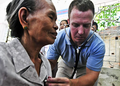 VINH, Vietnam (July 12, 2012) Lt. Cmdr. Marion Gregg listens to the lungs of a Vietnamese woman at a medical civic action project site at Nguyen Thi Minh Khal Primary School during Pacific Partnership 2012. (Photo by Kristopher Radder)