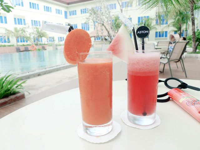 carrot juice and watermelon juice by the pool