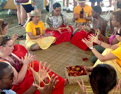 <p>University of Hawaii delegates teach hei, a traditional Hawaiian string game, at the UH tent at the Smithsonian Folklife Festival.</p>