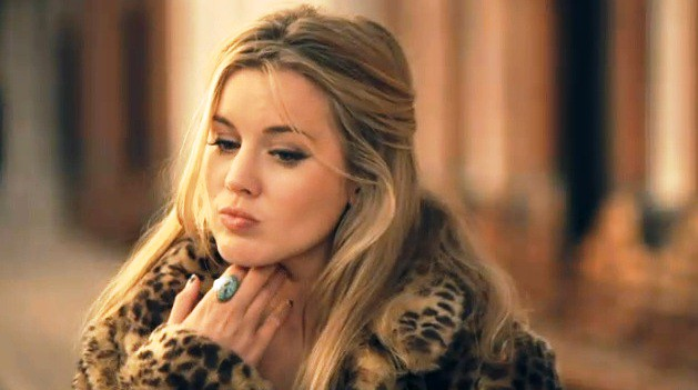 Caggie Dunlop faux animal fur jacket and turqoise ring