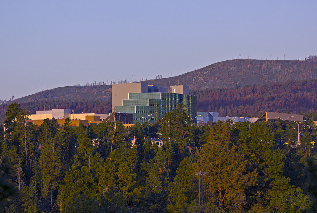 Los Alamos National Laboratory sits on top of a once-remote mesa in northern New Mexico with the Jemez mountains as a backdrop to research and innovation covering multi-disciplines from bioscience, sustainable energy sources, to plasma physics and new materials