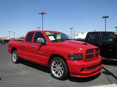 automobile(1.0), automotive exterior(1.0), pickup truck(1.0), dodge ram rumble bee(1.0), dodge ram srt-10(1.0), vehicle(1.0), truck(1.0), ram(1.0), bumper(1.0), land vehicle(1.0),