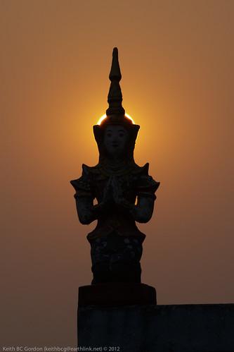 sunset silhouette statue temple haze laos huixia
