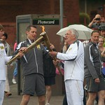 The Olympic flame is passed - Olympic torch carried through Burslem