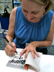 author Katherine Applegate signing a book for Maya