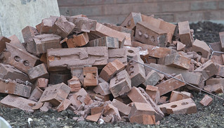Bricks pile up from the opening for the new Dining Services freezer.