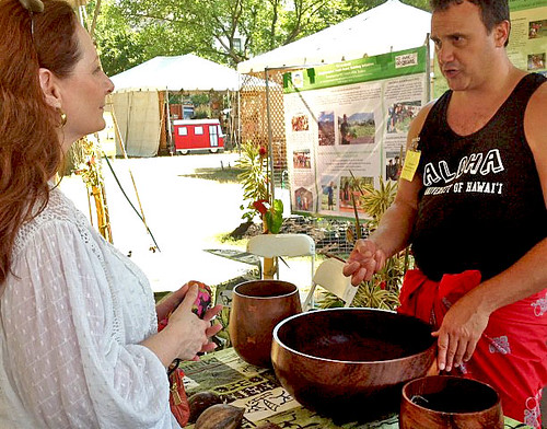 <p>University of Hawaii at Manoa Associate Professor Keawe Kaholokula, of the Department of Native Hawaiian Health, teaches visitors how to make awa at the University of Hawaii exhibit at the Smithsonian Folklife Festival.</p>