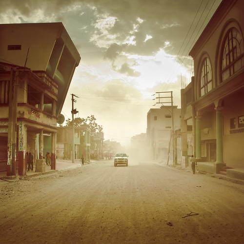 street sunset car june movie drive golden haiti nikon shine central western artdeco dust nikkor rue 18200 gravel showdown portauprince pavée ruepavee d300s centralportauprince