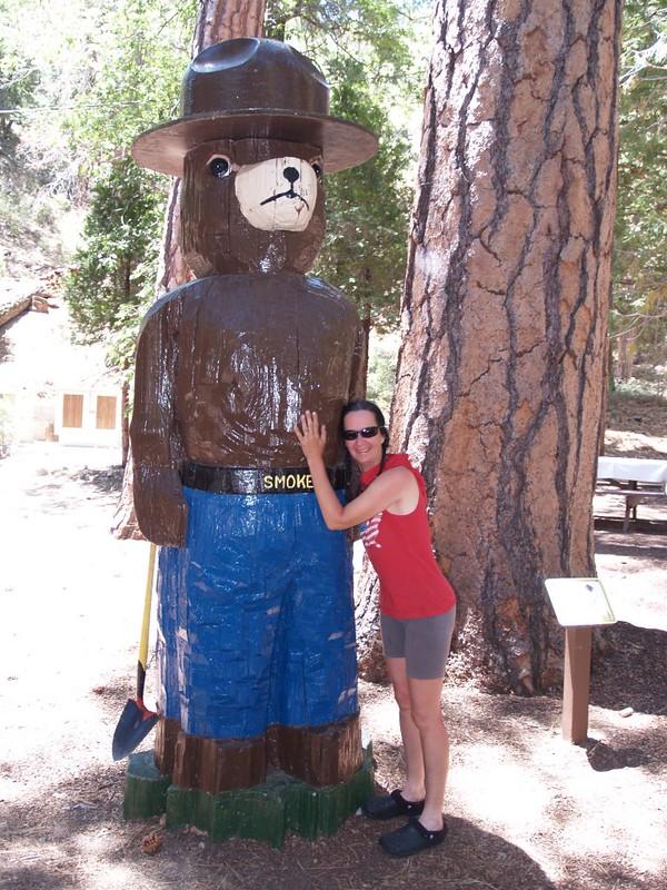Vicki hugging Smokey the Bear at the Barton Flats Visitor Information Center