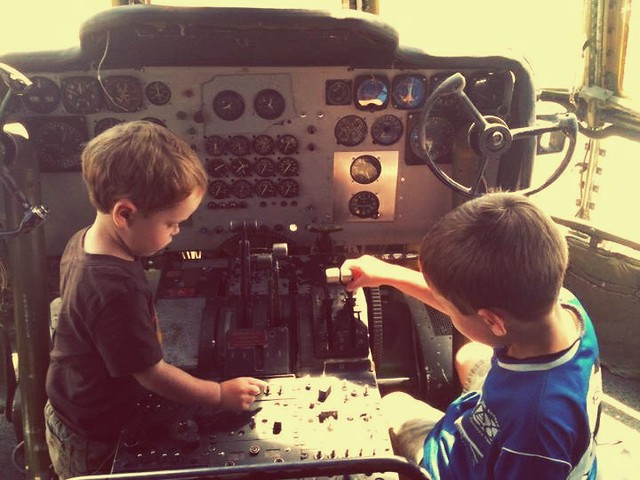 Kids playing in the cockpit at The Airplane Restaurant