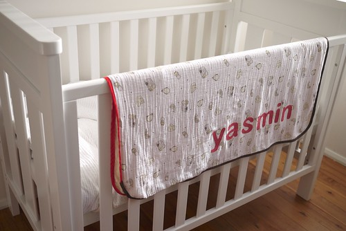 Muslin blanket on crib rail