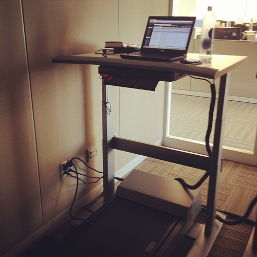 My desk for the day! Why yes that is a treadmill