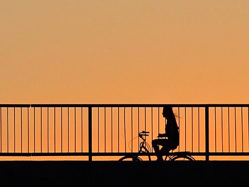 road bridge sunset sky orange black girl bicycle silhouette july 2012 project52