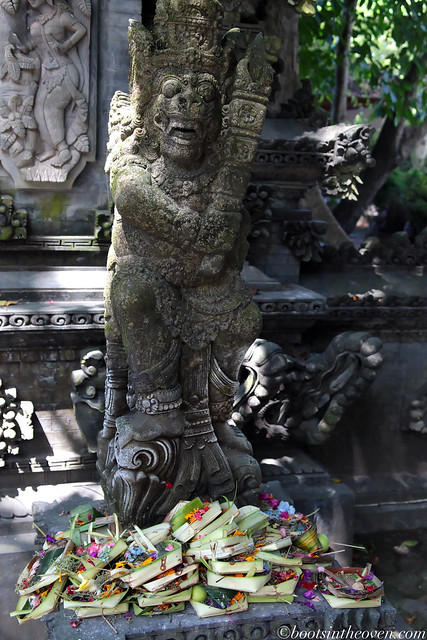 Offerings piled at base of statue